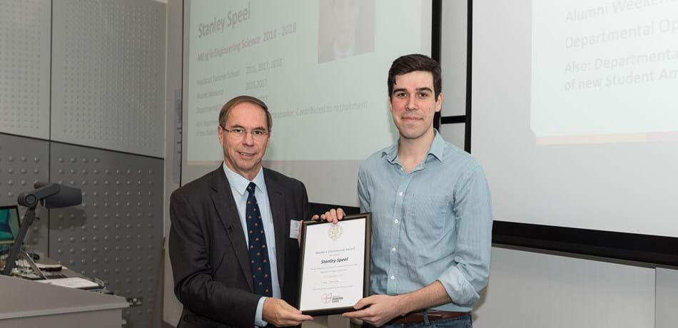 DPhil student recieves Matthew Greenwood award, from head of the department in 2018 Prof Lionel Tarassenko