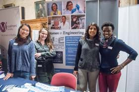 Female DPhil students at Women in Engineering network stall at a women in STEM event