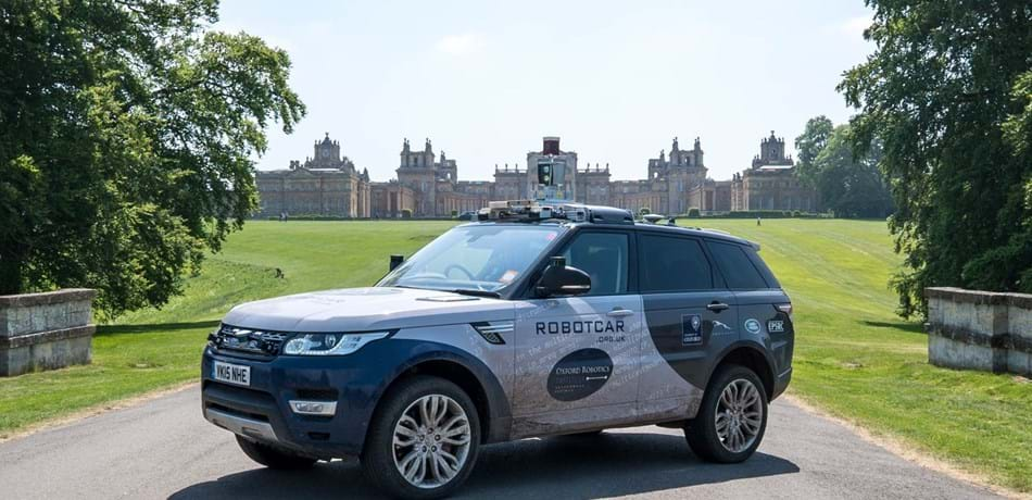 Oxford Robotics Institute vehicle on drive with Blenheim Palace in background