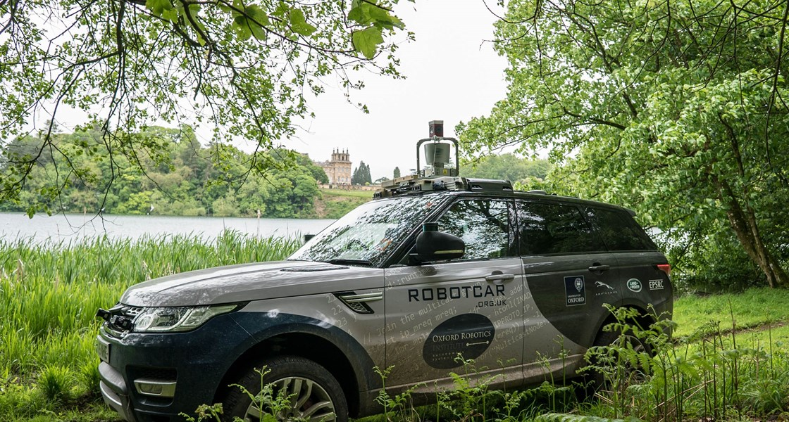 Oxford Robotics Institute vehicle offroad at Blenheim Palace with lake in background