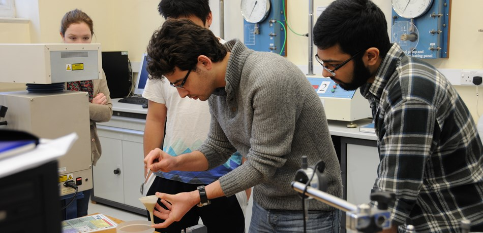 Group of students in lab working with soil sample