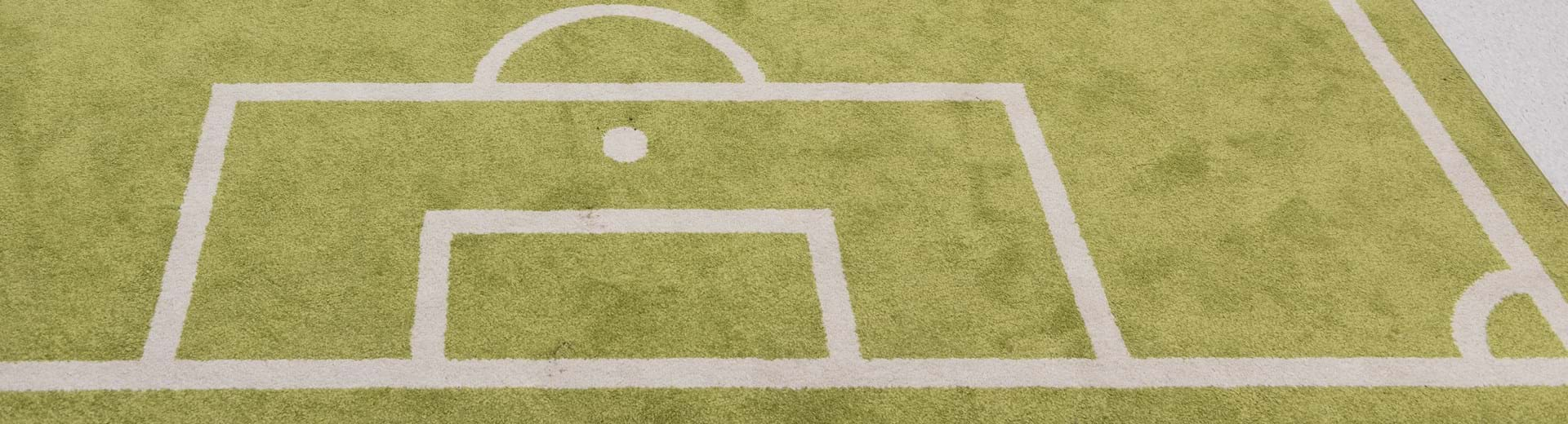 Very small robot on a miniature football pitch