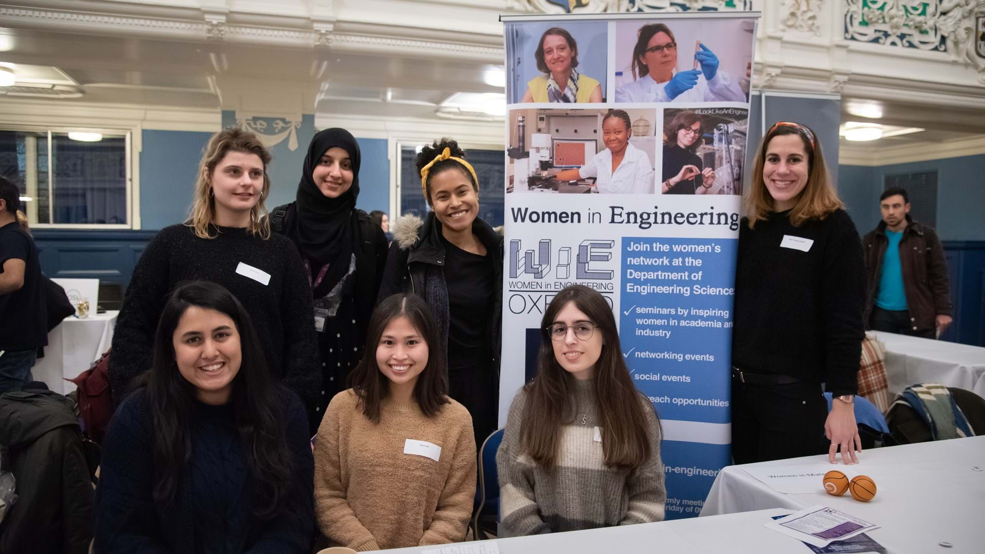 Female DPhil students at Women in STEM event in Oxford Town Hall, January 2020. Stood by Women in Engineering network banner