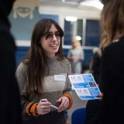 Women in STEM event, January 2020. Female engineers chatting at a stall