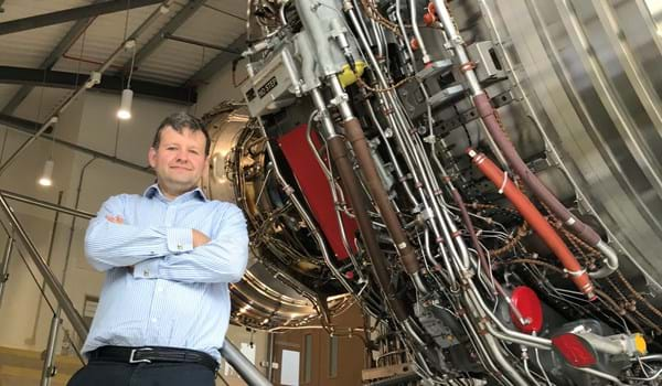 Mark Bacic in Thermofluids Institute with an aeroplane engine