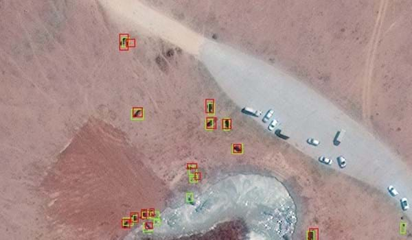 Example of CNN detections in Maasai Mara, Kenya from Geoeye‐1 Satellite, with CNN detections (green boxes) and ground truth labels (red boxes). Satellite image (c)2020 Maxar Technologies